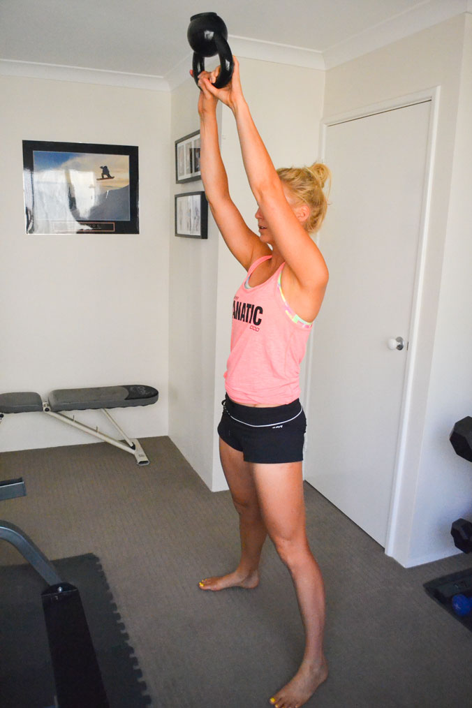 The mid-movement position of the kettle bell swing.